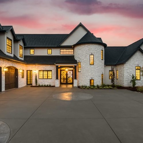 Beautiful,Luxury,Home,Exterior,At,Twilight,With,Colorful,Sunset,Sky